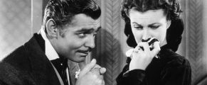 American actor Clark Gable (1901 - 1960) in his role as Rhett Butler kissing the hand of a tearful Scarlett O'Hara, played by Vivien Leigh in 'Gone With The Wind'.   (Photo by Hulton Archive/Getty Images)